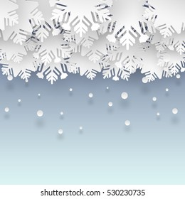 vector clouds of snowflakes on blue backdrop with falling snow for winter background design or christmas greeting card, paper cut out art style