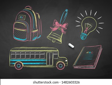 Vector collection of color chalk drawn illustrations of education items on chalkboard background.