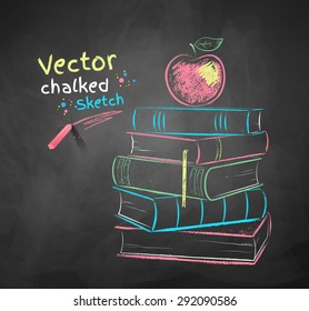 Vector color chalk drawing of apple on books