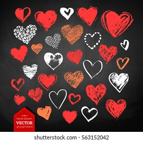 Vector color, red, orange and white chalk drawn collection of grunge Valentine hearts on blackboard background.