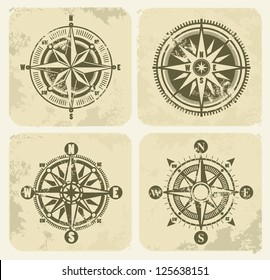 vector color vintage compasses with grunge on background