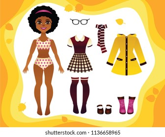 Vector colorful game of a paper doll with fashionable autumn clothes collection. Pretty young African American girl with school uniform, rain coat, rubber boots and accsessories
