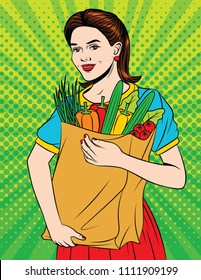 Vector colorful pop art style illustration of a young beautiful woman with full paper bag of health food. Happy beautiful girl doing grocery shopping