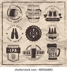 Vector craft beer labels and logos. Set of retro beer badges on vintage paper background.