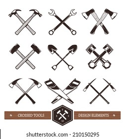 Vector crossed hard work tools. Set of useful elements for emblems, badges or any other retro designs.