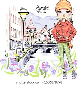 Vector cute blond girl in autumn clothes, headscarf and boots, jacket and jeans in Old Town of Annecy, France