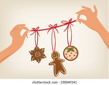 Vector cute hands holding a Christmas garland with gingerbread cookies
