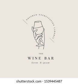 Vector design linear template logo or emblem - female hand holding glass of wine. Abstract symbol for wine bar or sommelier courses