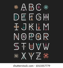 Vector display alphabet. Capital letters decorated with color floral patterns on a black background.