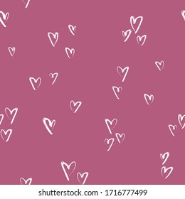 Vector ditsy seamless pattern with hearts. Valentines day background. Hand drawn illustration on pink background.