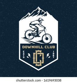 Vector downhill mountain biking badge, logo, label with rider on a bike and mountain silhouette. Downhill, enduro, cross-country biking illustration