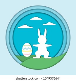 Vector Easter card template. Easter holiday illustration with  a rabbit and egg on a green hills, clowds and a blue  background. Paper cutout effect