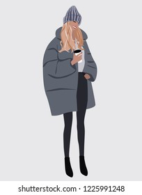 Vector fashion illustration of smiling trendy modern girl with cup of coffee in grey winter coat and grey hat. Fall winter trendy collection. Flat Graphic