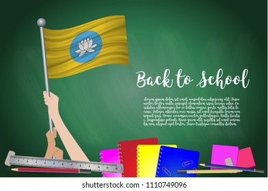Vector flag of Kalmykia on Black chalkboard background. Education Background with Hands Holding Up of Kalmykia flag. Back to school with pencils, books, school items learning and childhood concept.