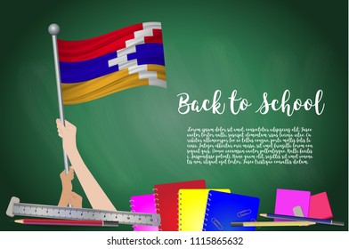 Vector flag of Nagorno Karabakh on Black chalkboard background. Education Background with Hands Holding Up of Nagorno Karabakh flag. Back to school with pencils, books, school items learning