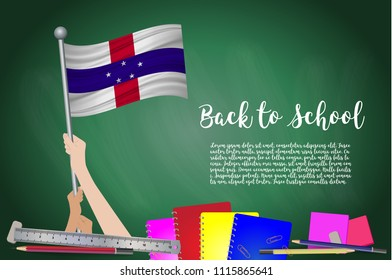 Vector flag of Netherlands Antilles on Black chalkboard background. Education Background with Hands Holding Up of Netherlands Antilles flag. Back to school with pencils, books, school items learning