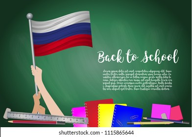 Vector flag of Russia on Black chalkboard background. Education Background with Hands Holding Up of Russia flag. Back to school with pencils, books, school items learning and childhood concept.