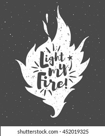 Vector flame with lettering and grunge texture. Light my fire. Burning bonfire silhouette with motivation quote and sparks. Illustration or background with space for your text.