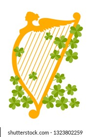 Vector flat style illustration with orange harp silhouette and clover leaves. Decorative element for Saint Patrick's Day designs.