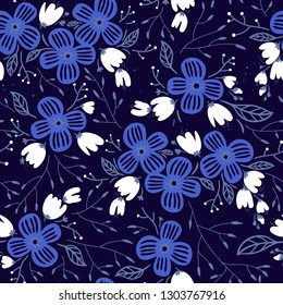 vector floral seamless pattern with abstract blooms on a dark blue background