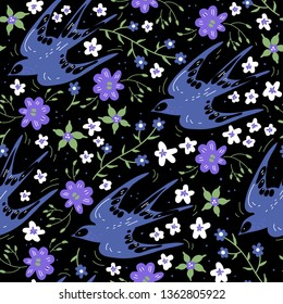vector floral seamless pattern with flying swallows and spring flowers on a black background