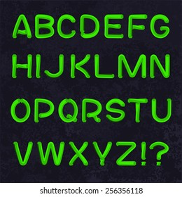 Vector font in the form of a twisted hexagonal rod. Green neon letters on a dark abstract background.