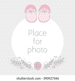Vector frame for a photo with baby booties and floral design elements. Background polka dot pattern. Scrapbooking album page.