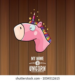 vector funny cartoon cute pink fairy unicorn head with horn isolated on wooden background. My name is unicorn vector concept illustration. funky hand drawn kids animal character