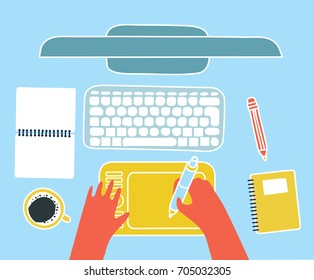 Vector funny colorful cartoon illustration of top view mock-up of graphic designer workplace. Computer monitor, keyboard, headphones, pencil, cup of coffie, notebook and tablet