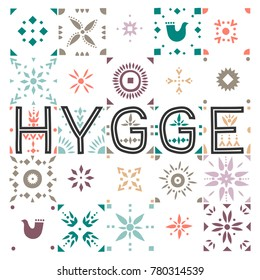 Vector geometric colored tiled pattern with the lettering Hygge (danish lifestyle).