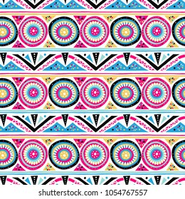Vector geometric ethnic pattern with circles, triangles, stripes, lines and mandalas. Tribal background in bright pink colors fro spring summer fashion. Bold print in bohemian and boho chic style