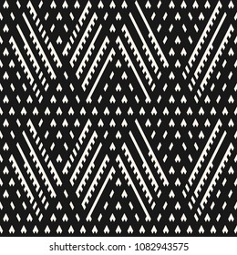 Vector geometric seamless pattern. Ethnic tribal style. Abstract black and white knit texture. Graphic ornamental background with diagonal lines, rhombuses, triangles, grid, lattice. Modern design