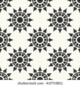 Vector geometric seamless pattern. Ethnic seamless background. Abstract flowers textile print. Round shapes fabric swatch. Monochrome wallpaper.