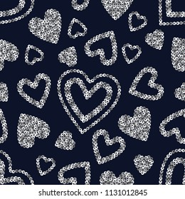 Vector geometric sparkle seamless pattern with silver sequins hearts on blue background