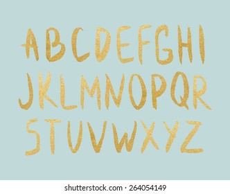 Vector gold foil letters on mint background. Hand drawn golden letters. Vector modern type.