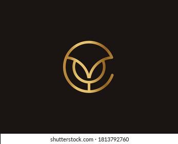 Vector Gold Letter YC logo templates isolated on black background. Modern Elegant Circle Linked Design