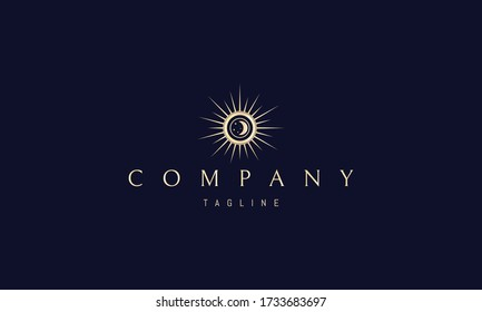 Vector golden logo on which an abstract image of the sun with rays in the center of which the moon and stars.