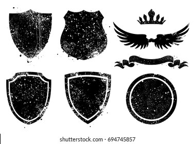 Vector grunge shileds, crown, wings and ribbon.