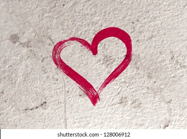 Vector grungy old concrete wall background with hand painted heart