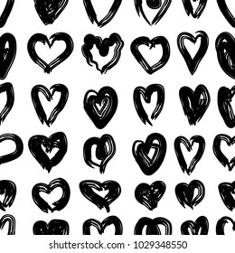 Vector hand drawn doodle seamless background with hand drawn hearts.