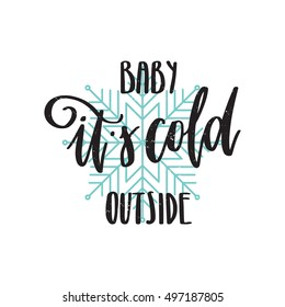 Vector hand drawn greeting card - Baby it's cold outside. Black calligraphy isolated on white background with blue snowflake