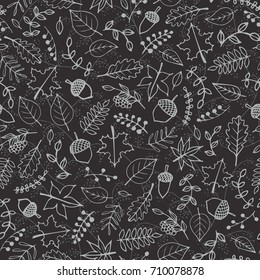 Vector hand drawn pattern with autumn elements contours: foliage, berries and acorns on the dark gray background. Maple, sycamore, birch, beech and oak tree leaves. Chalkboard imitation.