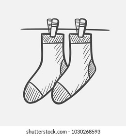 Vector hand drawn socks hanging on the clothesline outline doodle icon. Socks hanging on the clothesline sketch illustration for print, web, mobile and infographics isolated on white background.