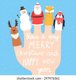 "Vector holiday background with finger puppets. Winter cartoon characters: fox, deer, snowman, Santa Claus, penguin. Card with hand written text ""Have a very merry Christmas and happy New Year""."