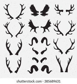 Vector Horns set silhouette on the grunge hipster background. Grunge effect isolated.