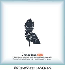 Vector icon silhouette of a hand with a torch