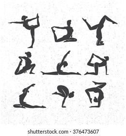 Vector icons of woman silhouettes in yoga poses