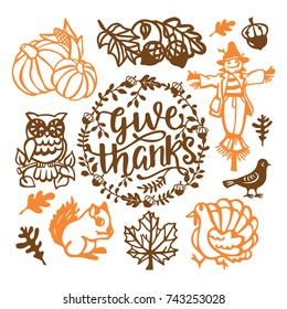 A vector illustration of assorted vintage thanksgiving fall paper cut design elements set like turkey, scarecrow, pumpkins and more.