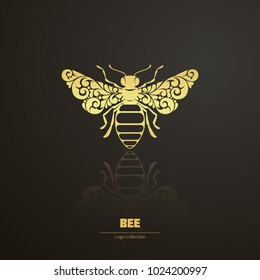 Vector illustration bee - symbol, icon, design element. Abstract Ornamental floral bold honeybee isolated on black background