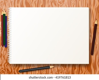 Vector illustration blank empty album for drawing format A4  with colored pencils. Clean notebook for sketches on wooden table, board, desk. Book sheet paper with spiral.